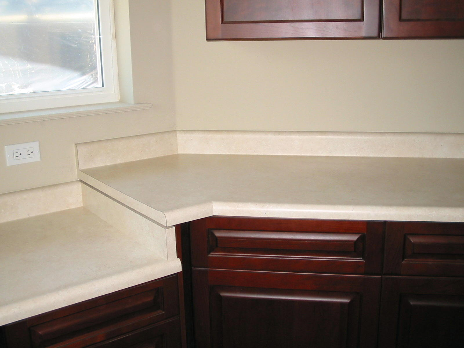 New Laundry Room Tops With No Drip Front Edge And Coved Waterfall Backsplash,  Fitted In Odd Angle Corner.