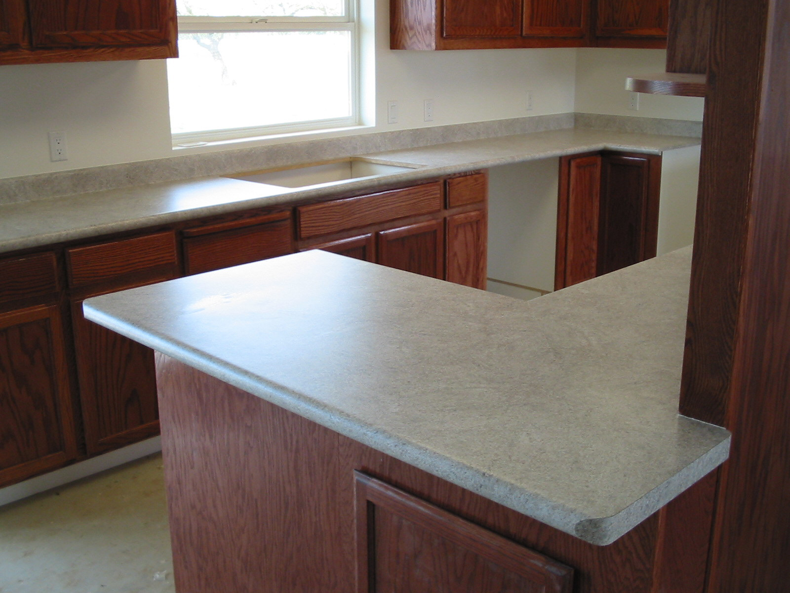 Countertop Drip Edge : Kitchen remodel with no-drip front edge and square edge on raised bar.